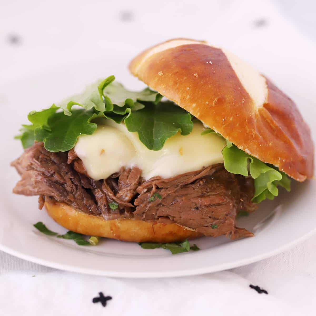 mississippi pot roast on a pretzel bun