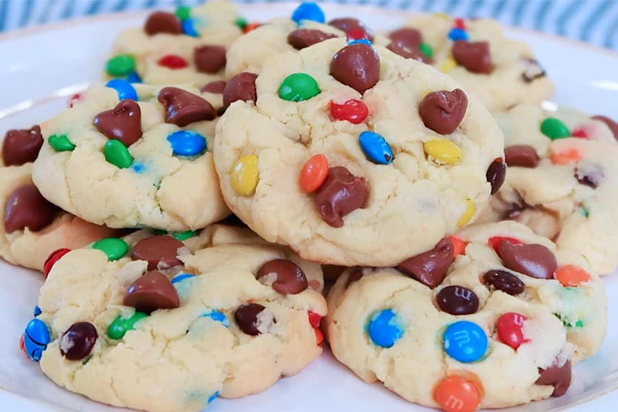 cake mix cookies with chocolate chips and m &Ms on a white plate