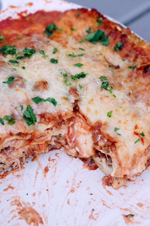 easy lasagna in a baking dish with a slice taken out