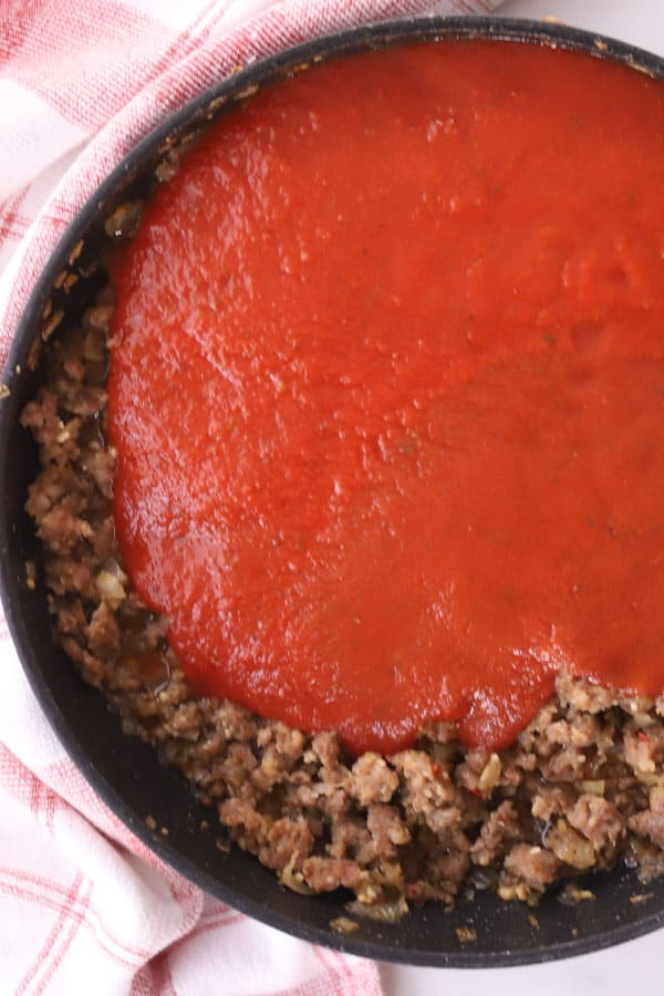 ground beef and marinara sauce in a saute pan