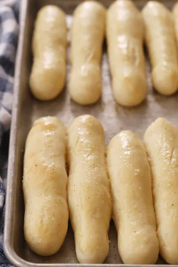 copy cat olive garden breadsticks rising on a baking sheet