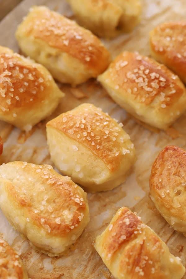 pretzel bites baked to golden brown on a baking sheet