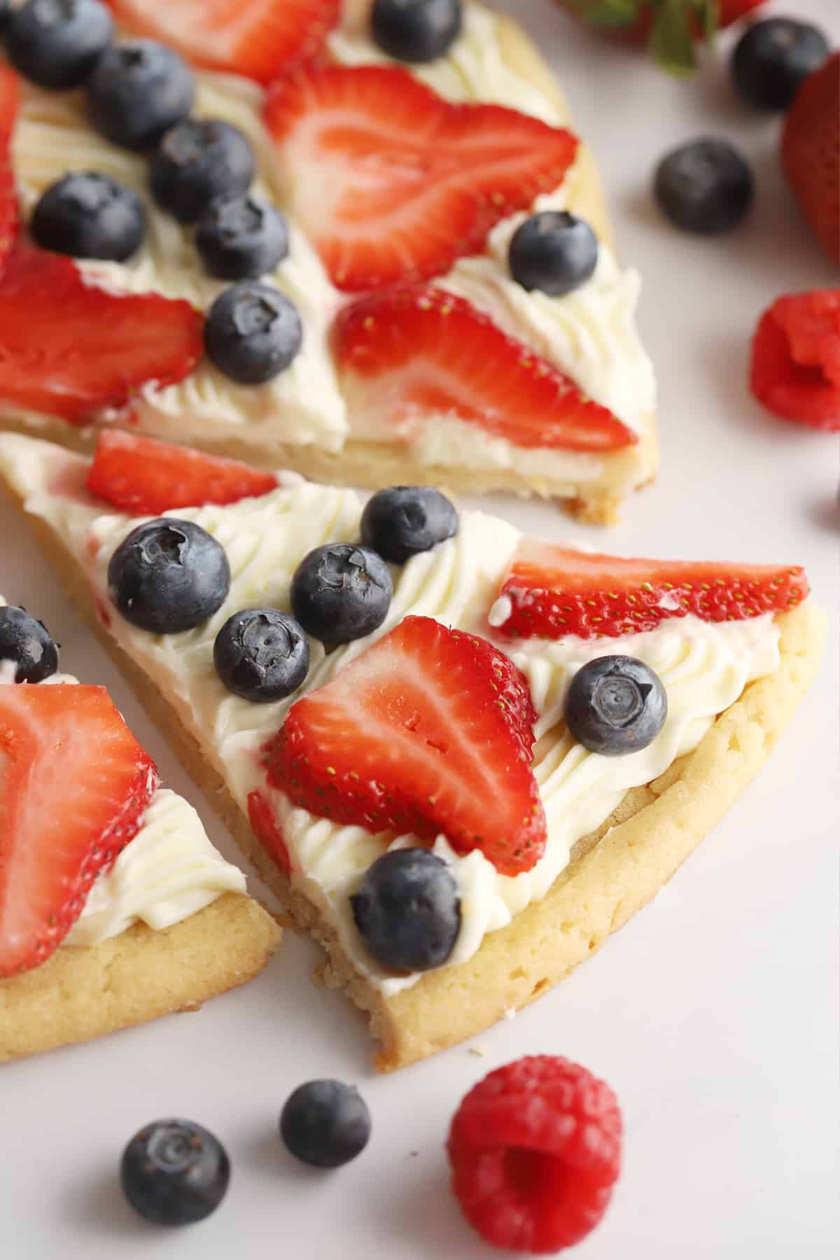 a wedge of fruit pizza cut