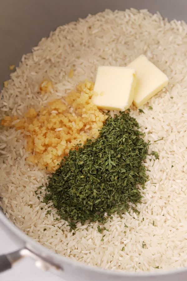 raw ingredients for garlic parmesan rice in a pot
