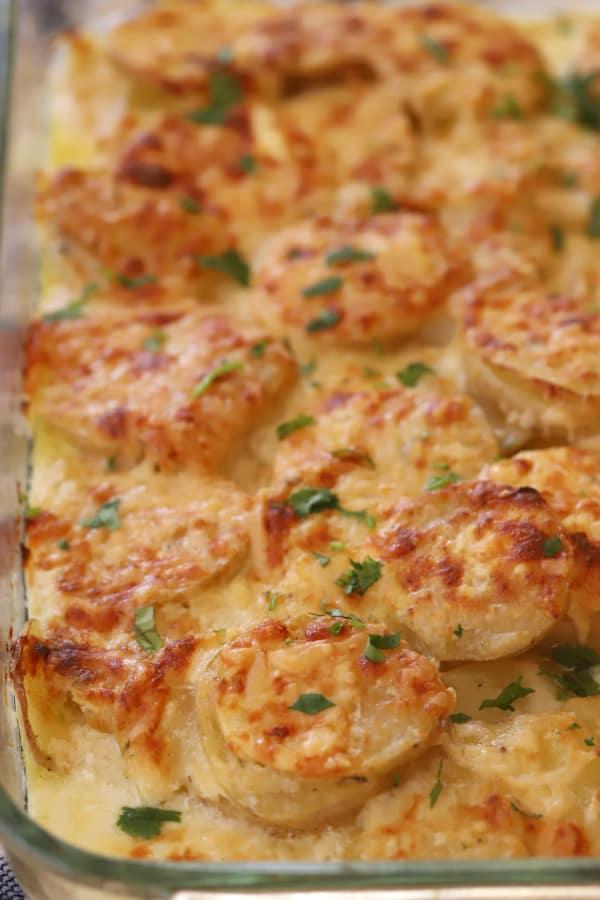 gruyere scalloped potatoes garnished with chopped parsley
