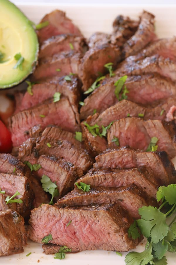 sliced steak garnished with cilantro