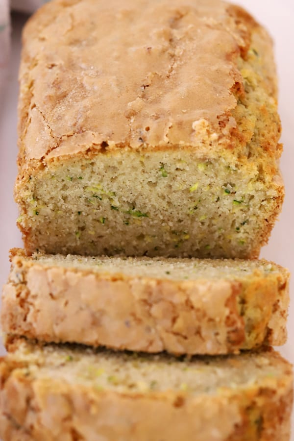 zucchini bread sliced with sugar crunch topping