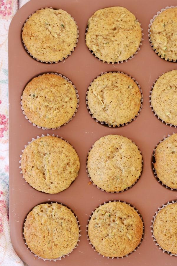 Unfrosted Zucchini Cupcakes in a muffin tin.