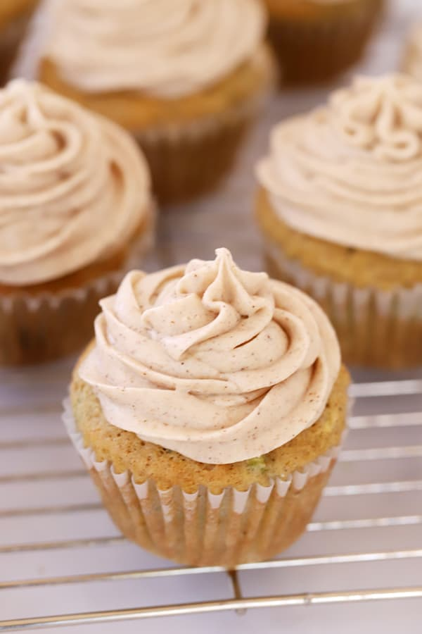 Zucchini Cupcakes with buttercream piped on top.