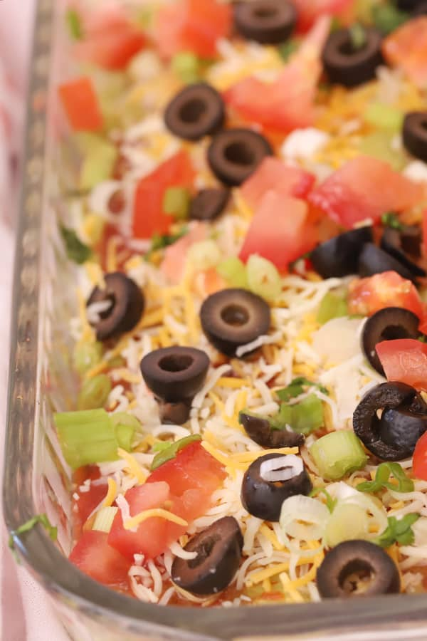 "7 layer bean dip in a glass 9x13"" baking dish."