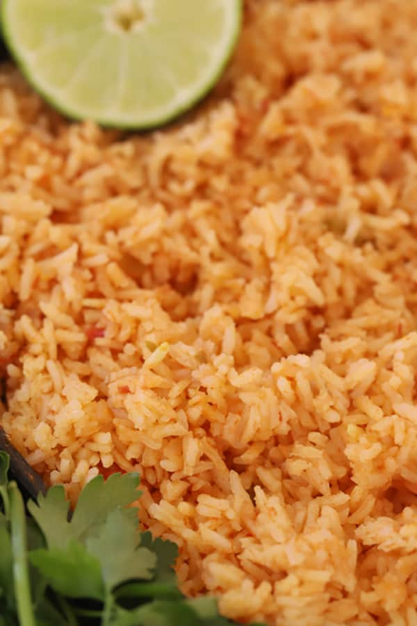 Spanish Rice garnished with fresh cilantro and lime.