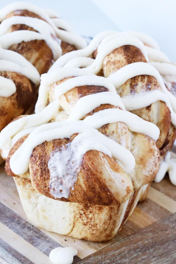 Loaf of Cinnamon Twist Bread drizzled with vanilla icing.