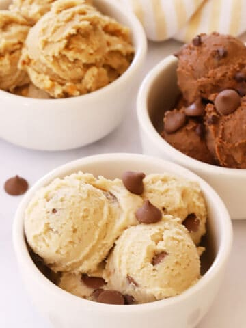 Three bowls with scoops of edible cookie dough.
