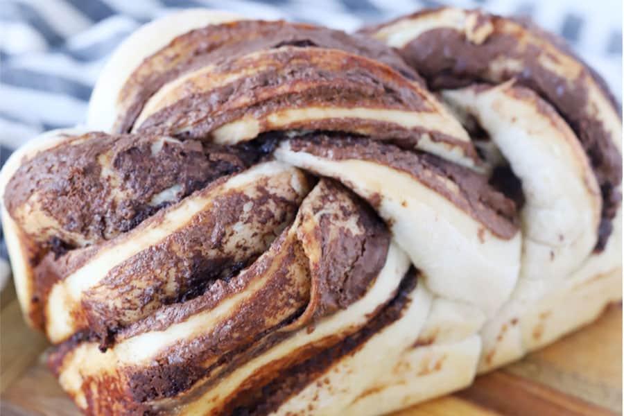 A loaf of Nutella swirl bread on a cutting board.
