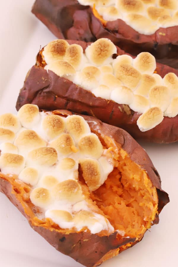 Sweet potatoes topped with mini marshmallows.