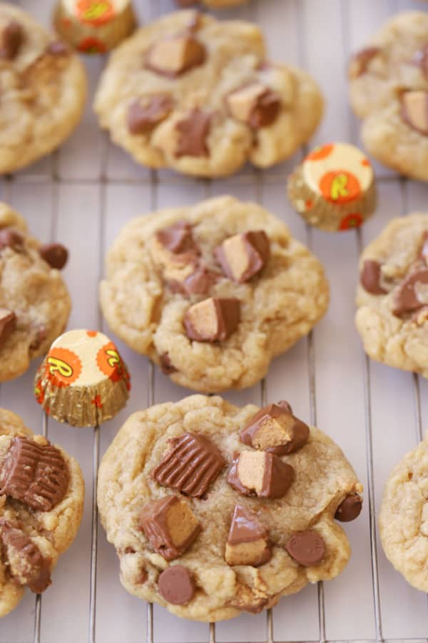 Reese's Peanut Butter Cup Cookies on a wire rack topped with chopped Reese's.