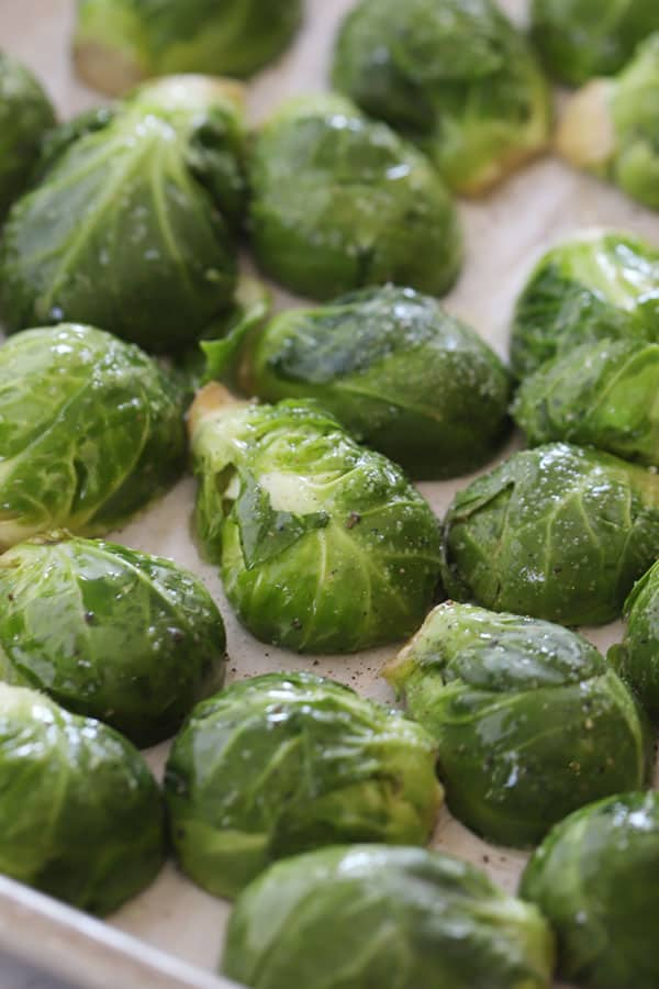 Brussels sprouts cut-side down on a baking sheet.