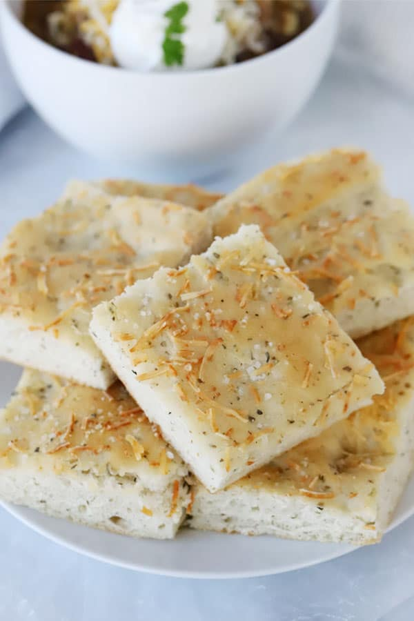 Squares of Italian Herb Focaccia Bread on a plate.