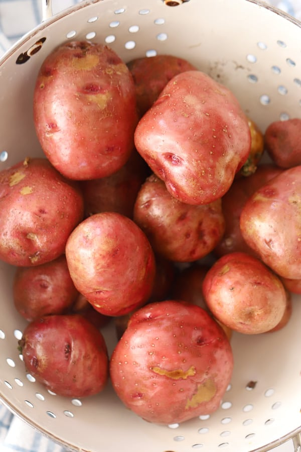 Red skin potatoes in a collander.