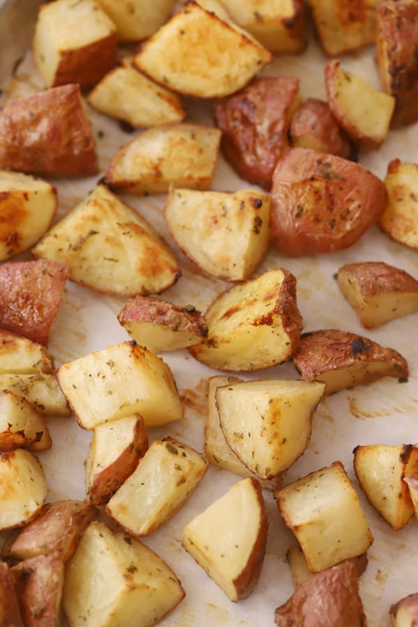 Oven Roasted Red Skin Potatoes on a sheet tray.