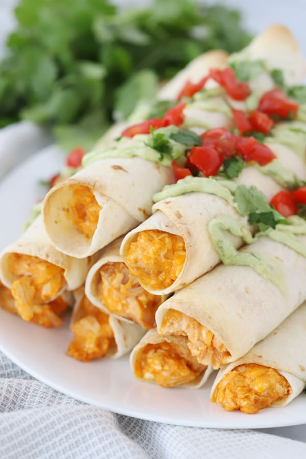 Buffalo chicken taquitos on a plate.