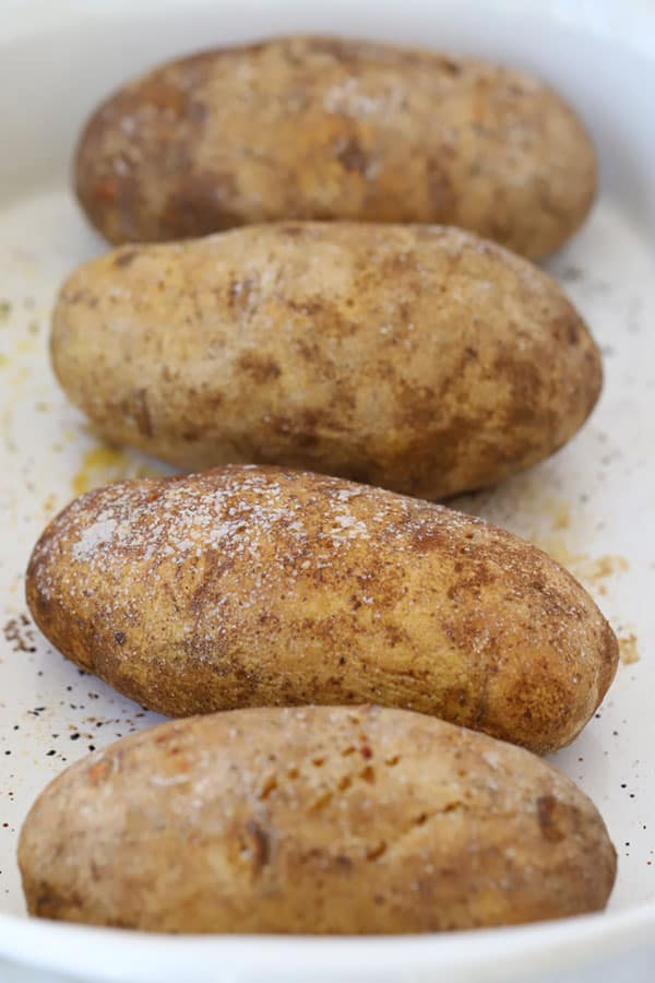 Potatoes in a baking dish sprinkled with salt.