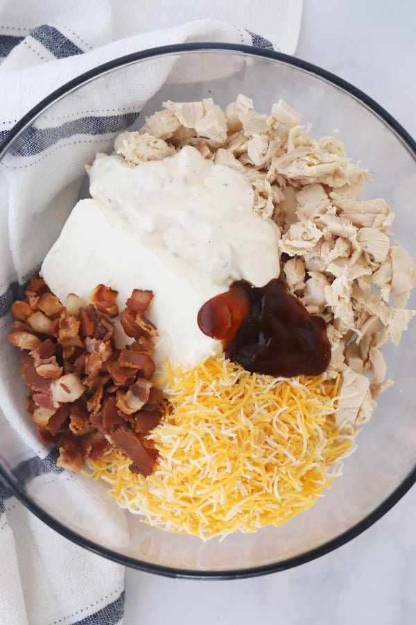 Ingredients to make BBQ chicken filling in a glass bowl.