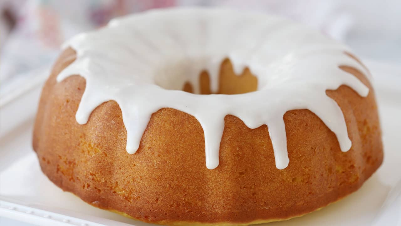 Horizontal picture of lemon bundt cake with white icing