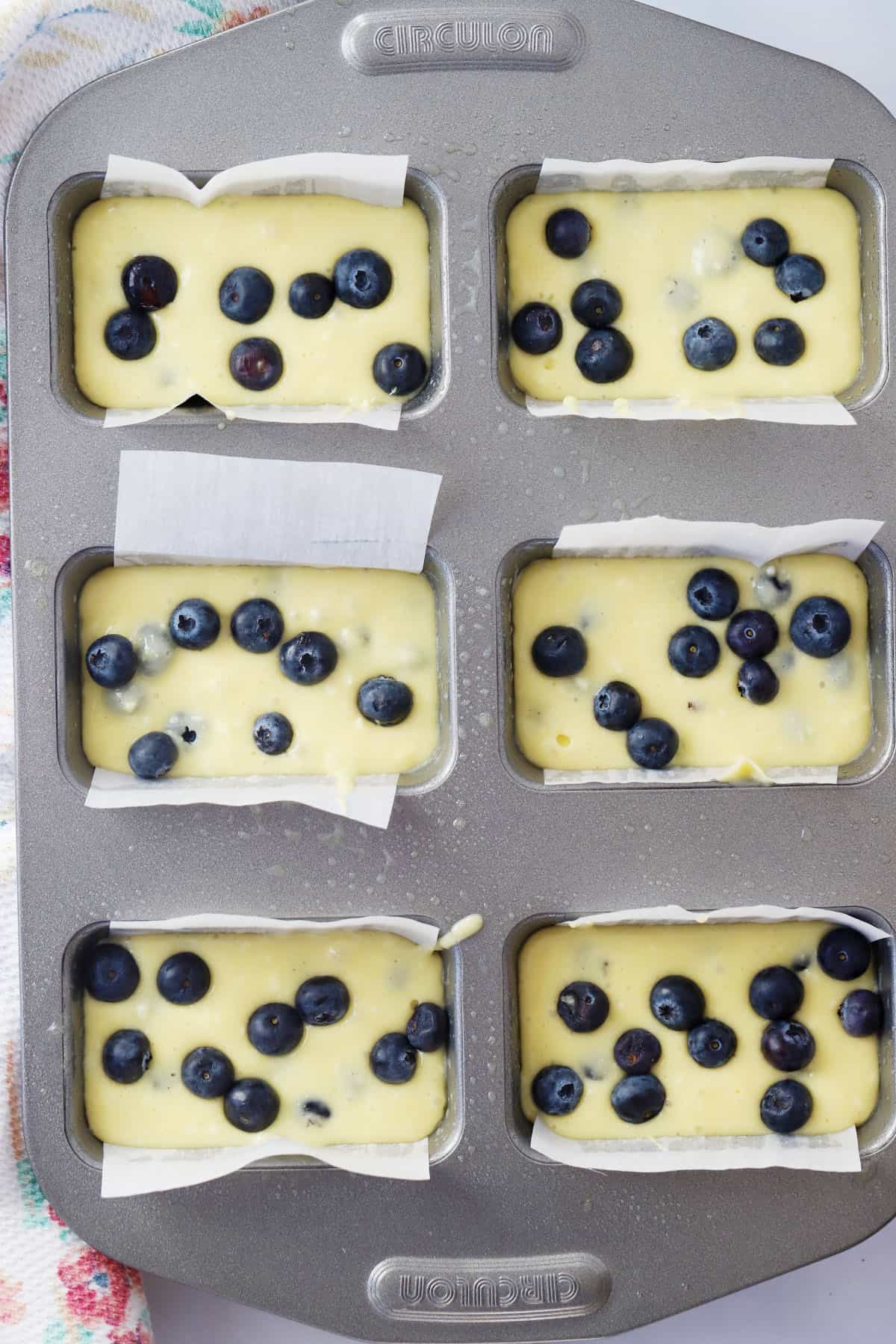 Circulon mini loaf pan filled with blueberry bread batter.