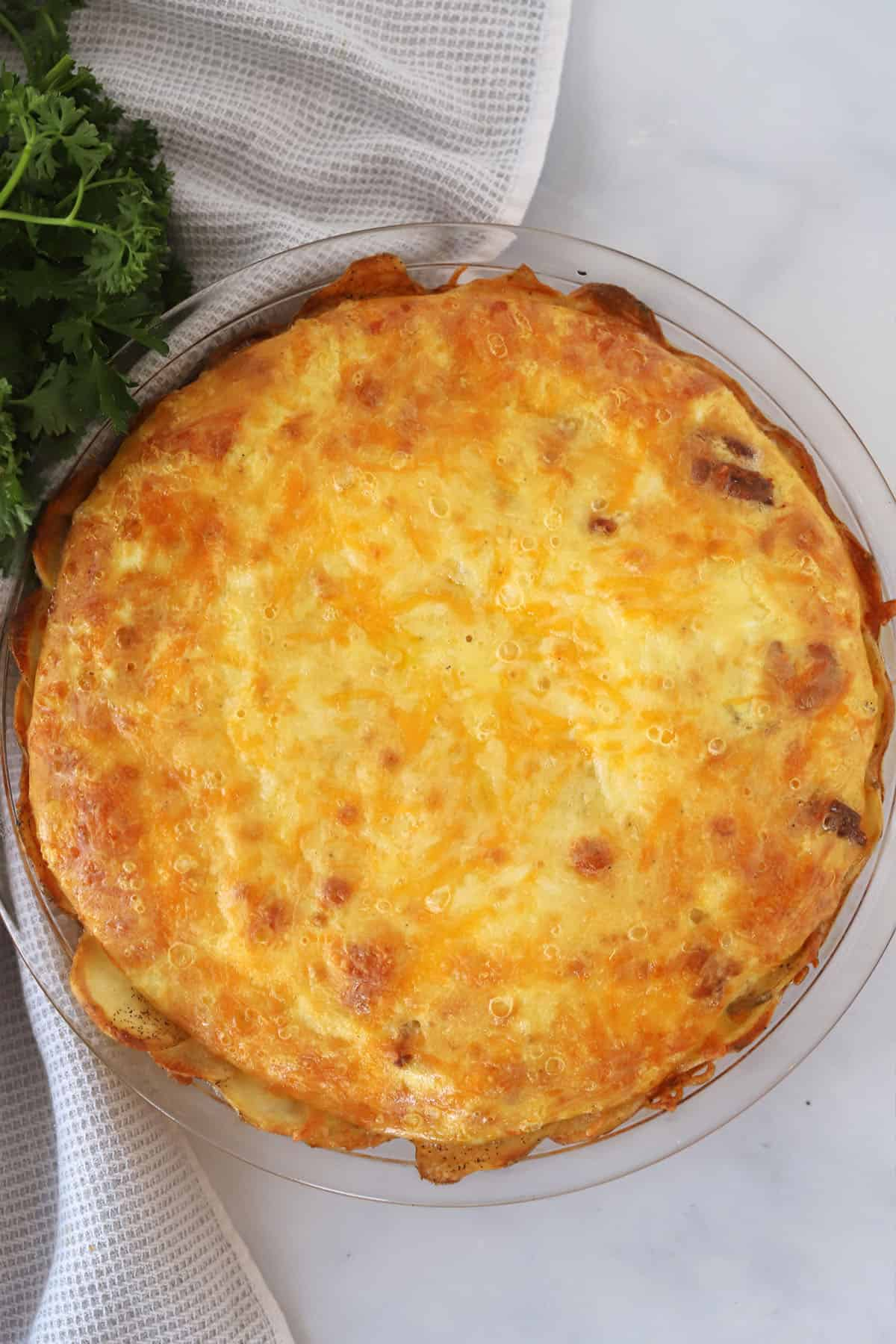 A baked quiche on a table.