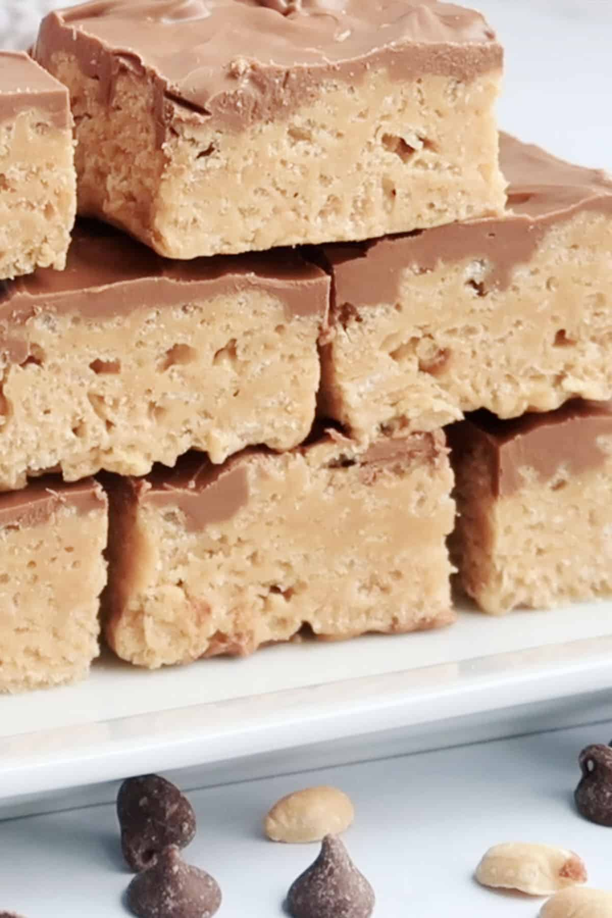 Scotcharoo bars stacked on top of each other on a plate.