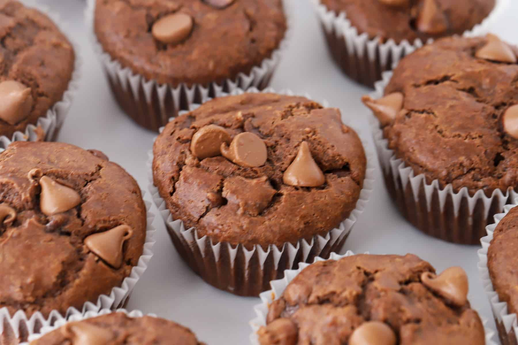 Double Chocolate Chip muffins on a table.