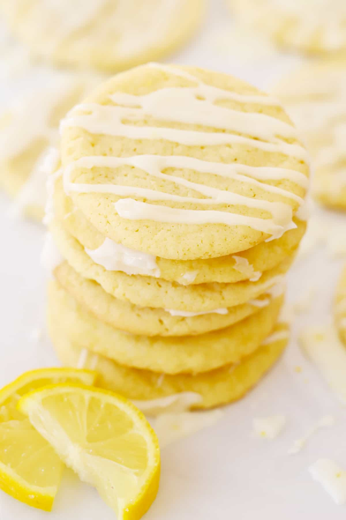 A stack of Glazed Lemon Cookies on a tray.