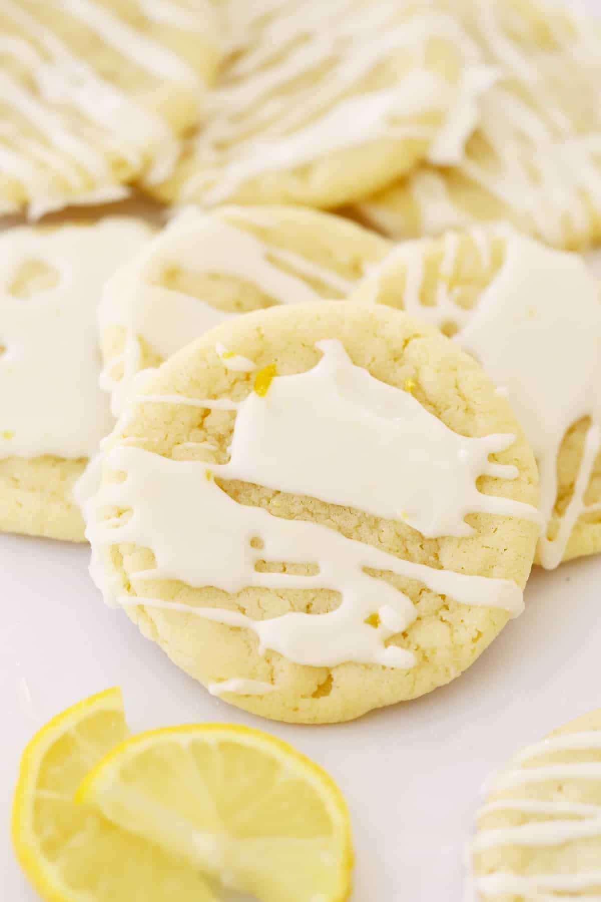 glazed lemon cookies on parchment paper