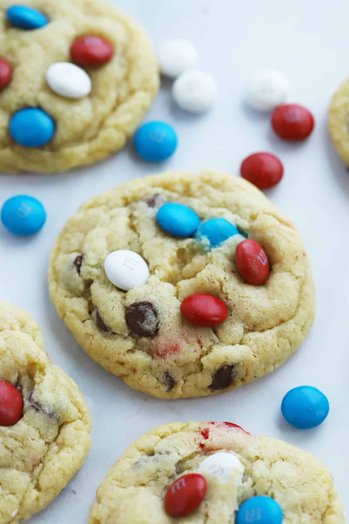 Chocolate Chip Cookies with red, white and blue M&Ms on a table.