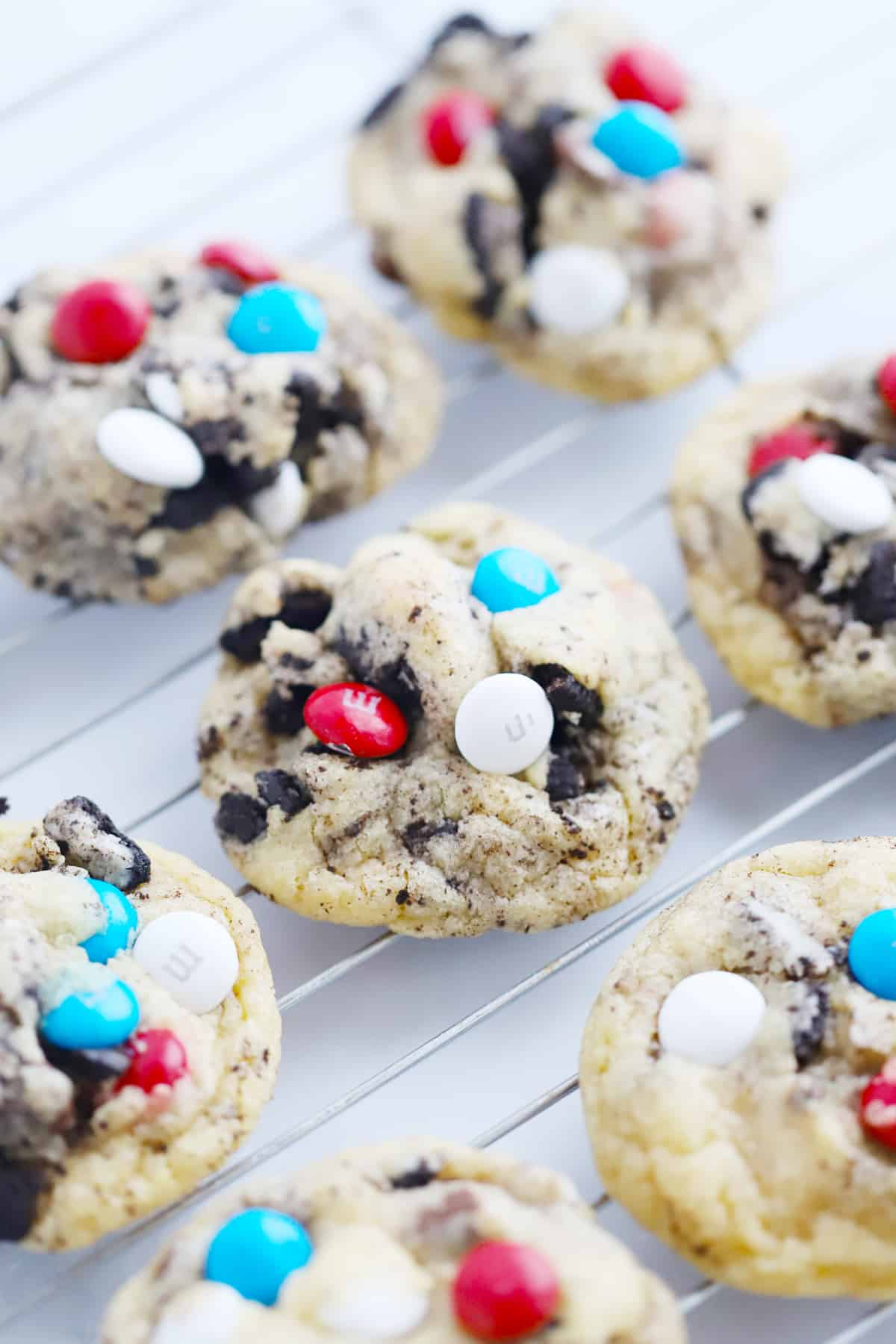 Oreo and M&M Cookies cooling on a baking rack.