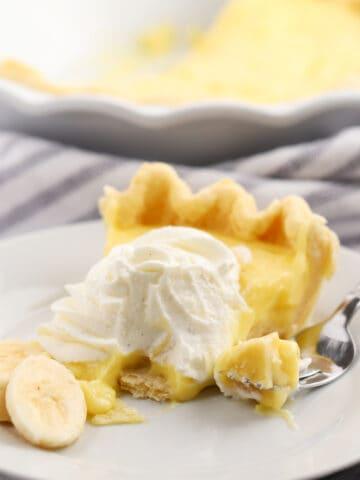 banana cream pie slice on a white plate