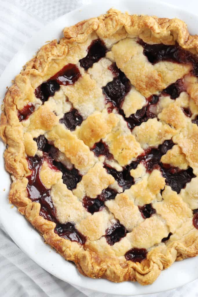 A photo from above of a baked pie with a lattice top.